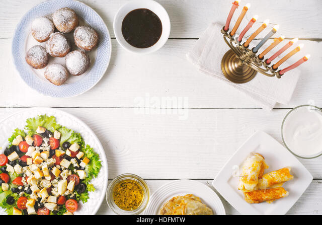Traditional Hanukkah  dishes on the white wooden table - Stock Image