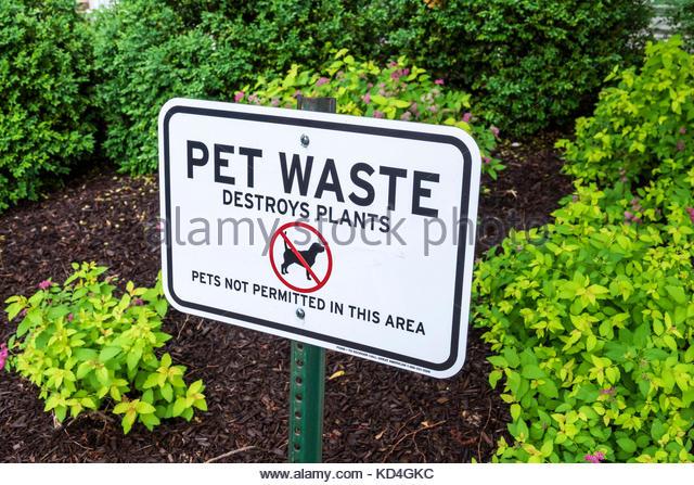 Washington DC District of Columbia Logan Circle neighborhood garden sign no pets pet waste - Stock Image