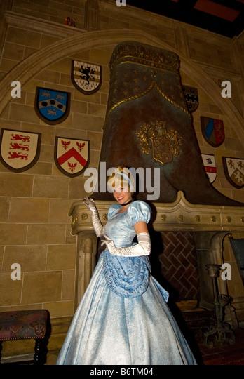 Cinderella in blue gown Cinderellas Royal Table restaurant Cinderella Castle Magic Kingdom Walt Disney World Orlando - Stock Image