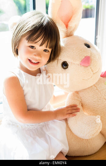 Sweet toddler girl with her Easter bunny - Stock Image