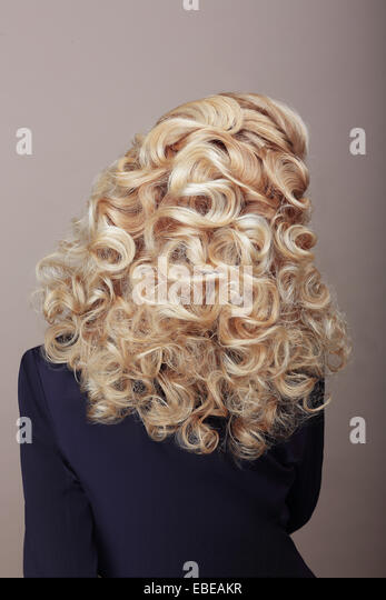 Rear View of Woman with Frizzy Ashen  Hairs. Festive Braided Hairdo - Stock Image