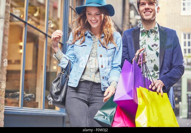 Stylish couple on shopping spree, London, UK - Stock Image