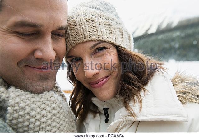 Portrait of smiling couple wearing warm clothing - Stock Image