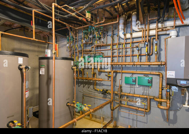 Copper Water Pipes In Basement Of New Large Home - Stock Image