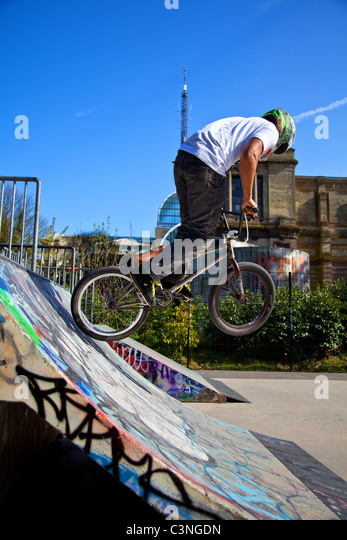 BMX biker performing tricks on a ramp - Stock Image