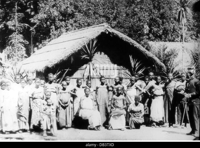 geography travel Africa Belgian Congo people Congolese group outside of a hut circa 1895 native natives inhabitant - Stock-Bilder