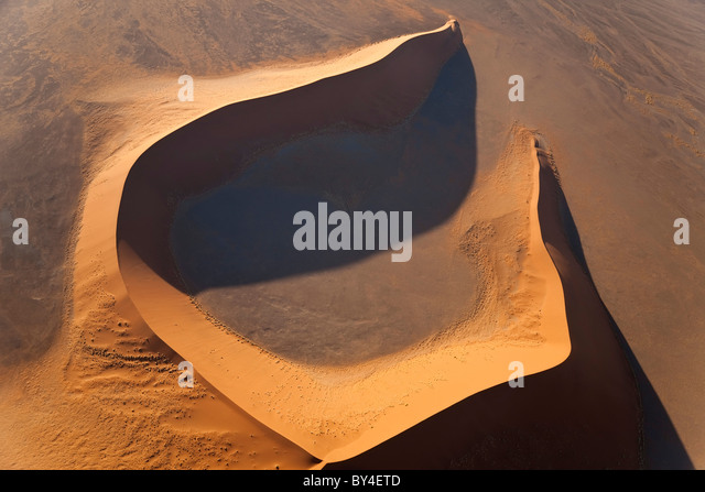 Aerial view over sand dunes, Namib Desert, Namibia - Stock Image