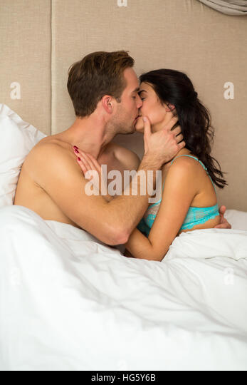 Pictures of man and woman in bed kissing