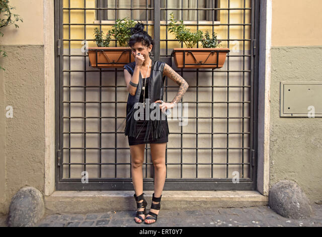 Posed portrait of an Italian beautician with tattoos in Rome, Italy - Stock Image