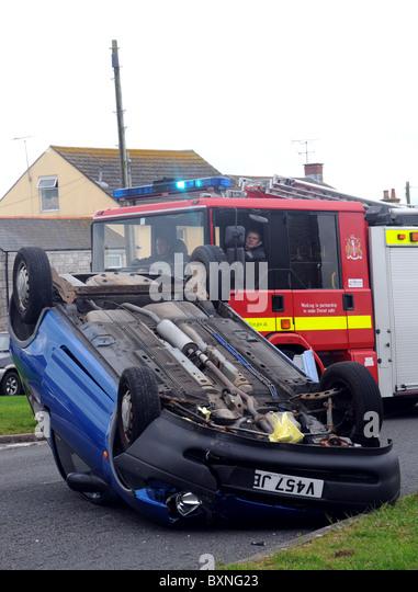 Car crash, overturned car after a traffic accident - Stock Image