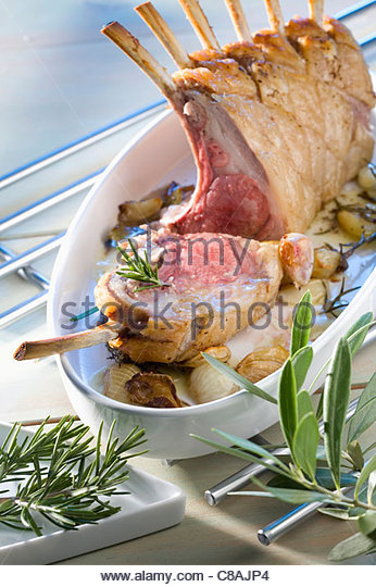 Loin of lamb with garlic and herbs - Stock Image