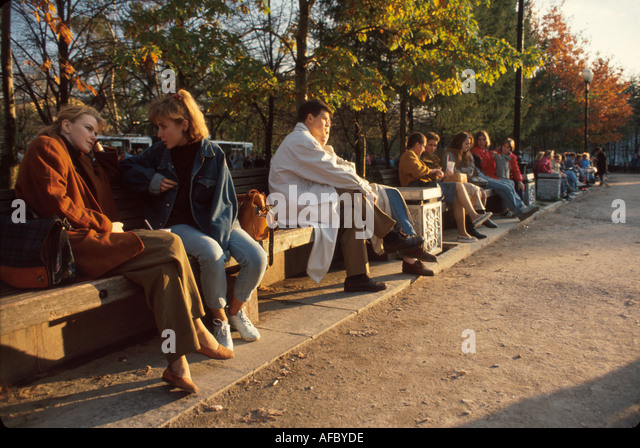 Russia former Soviet Union Moscow Pushkin Square residents park benches Sunday - Stock Image
