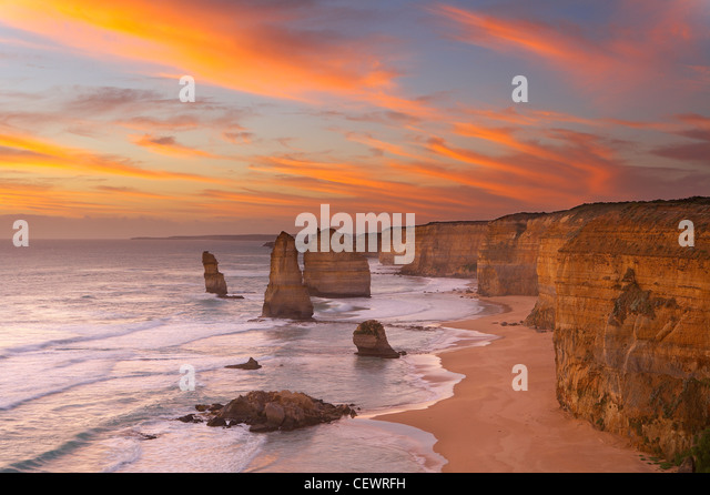 the eroded coastline of the Twelve Apostles at dusk, Port Campbell National Park, Great Ocean Road, Victoria, Australia - Stock Image