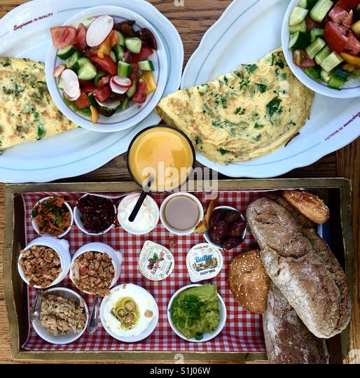 A colourful Israeli breakfast - Stock Image