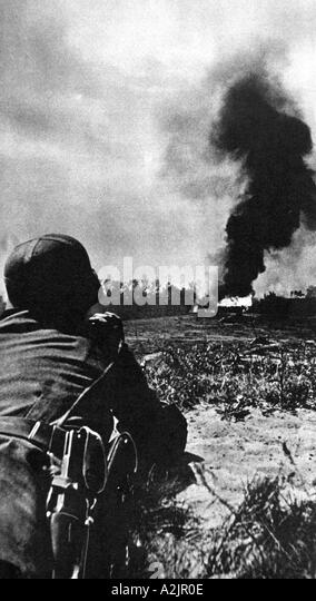 POLAND 1939 German observer watches an attack in progress by German forces - Stock Image