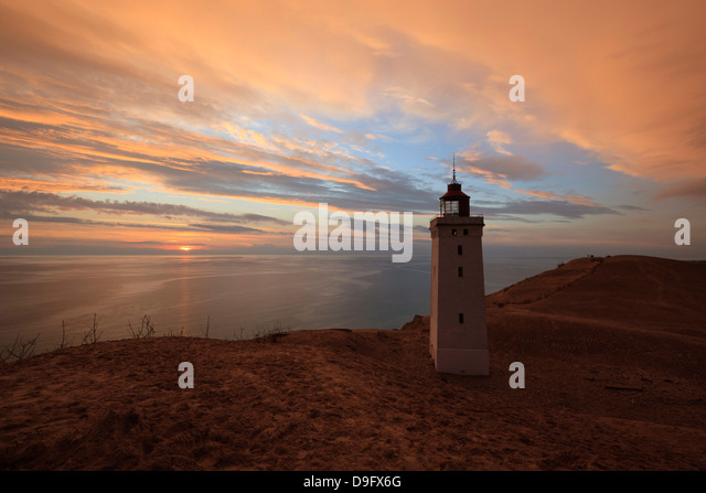 Rubjerg Knude Fyr (lighthouse) buried by sand drift at sunset, Lokken, Jutland, Denmark, Scandinavia - Stock Image