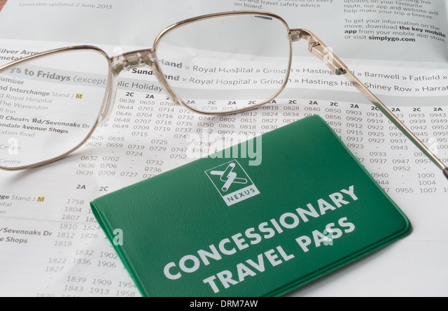Pensioner planning trip to hospital using concessionary travel or bus pass and bus timetable concept. - Stock-Bilder