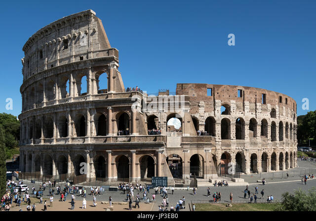 Tourist crowds at the Roman Colosseum in Rome, Italy. The name, since medieval times, of the Amphitheatrum Flavium, - Stock Image