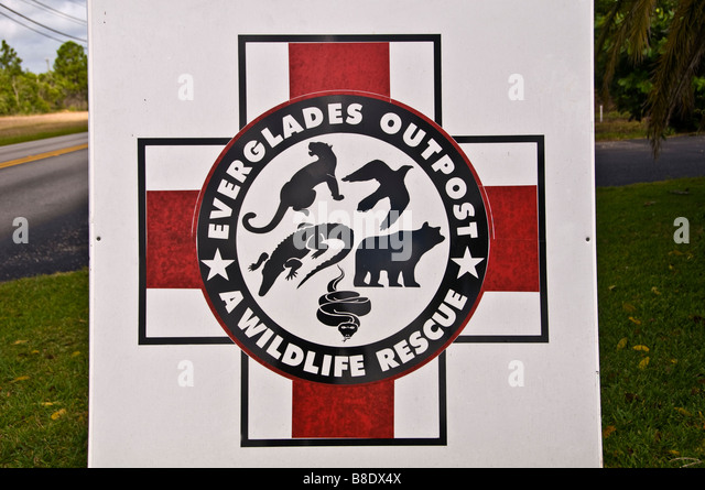 Everglades Outpost A Wildlife Rescue sign red cross Homestead Florida - Stock Image