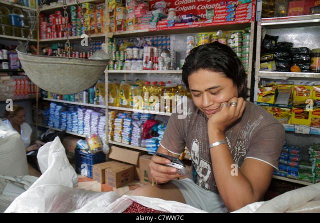 Managua Nicaragua Mercado Roberto Huembes market shopping marketplace vendor stall grocer shelves products Hispanic - Stock Image