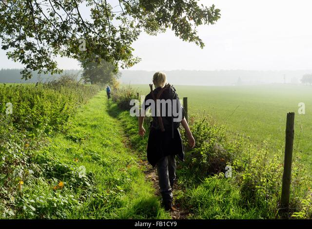 Rear view of teenage boy hiking along ancient roman path, Beaufort, Echternach, Luxembourg - Stock-Bilder