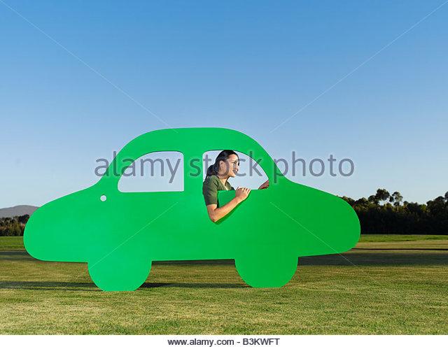 Woman driving cutout car - Stock-Bilder