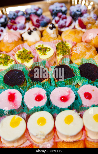 Fancy desserts lined-up - Stock Image