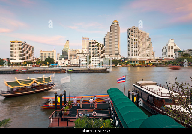 Chao Phraya river and the modern Bangkok skyline, Bangrak district, Bangkok, Thailand, Southeast Asia - Stock Image