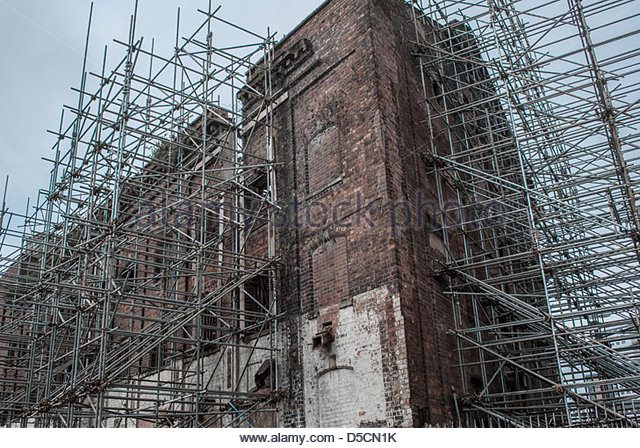 Scaffolding used to support unstable building, UK - Stock Image