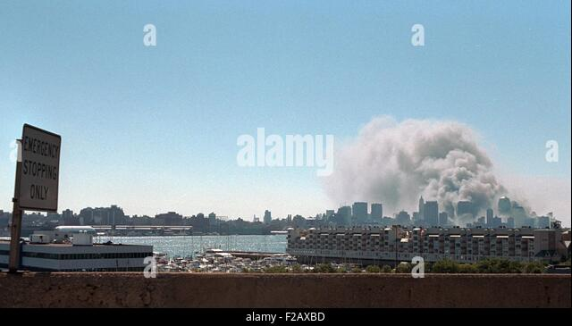 Smoke and pulverized building debris rise from the World Trade Center, Tuesday, Sept. 11, 2001. Photo taken from - Stock-Bilder
