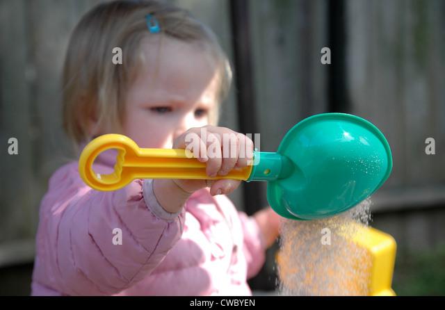 Toddler Plays In Sandbox - Stock Image