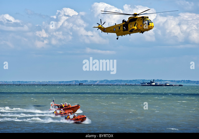 Yellow Air Sea Rescue Sea King Helicopter of 22 Squadron and RNLI RIB craft - Stock Image