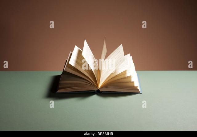 Open hardback book - Stock Image