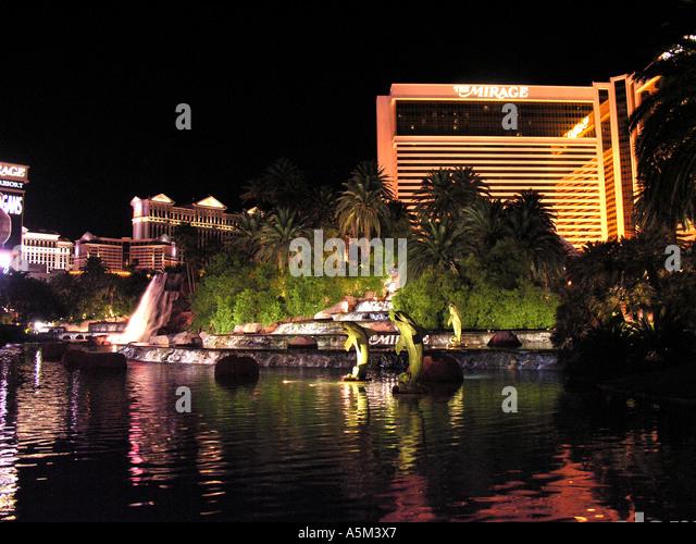Las Vegas strip night Mirage dolphin pond - Stock Image