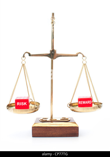 Weighing up the risks and rewards metaphor - Stock Image