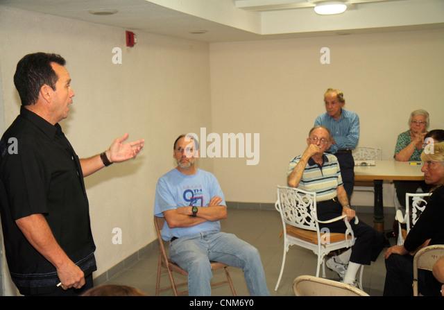 Miami Beach Florida Presidential Condominiums condo board meeting directors owners controversy senior man woman - Stock Image