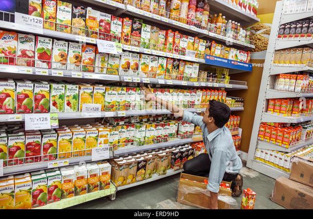 Mumbai India Asian Lower Parel High Street Phoenix mall inside shopping Big Bazaar supermarket grocery store man - Stock Image