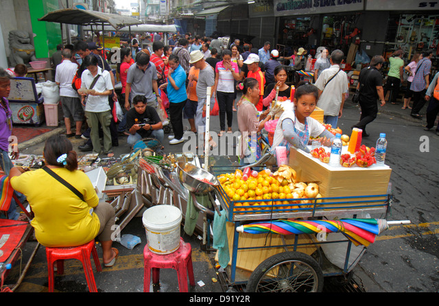 Bangkok Thailand Samphanthawong Chinatown street market marketplace shopping Asian street vendor juice drink teen - Stock Image