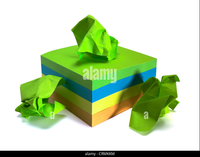 A block of coloured sticky notes, three crumpled up - Stock Image