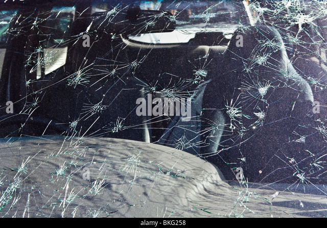 Cracked car windscreen from hail damage from the Perth Storm of 22/03/2010 - Stock Image