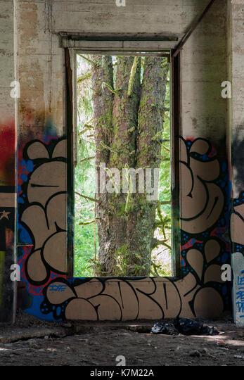 Window at Abandoned Power Station near Jordan River, Vancouver Island, British Columbia, Canada - Stock Image