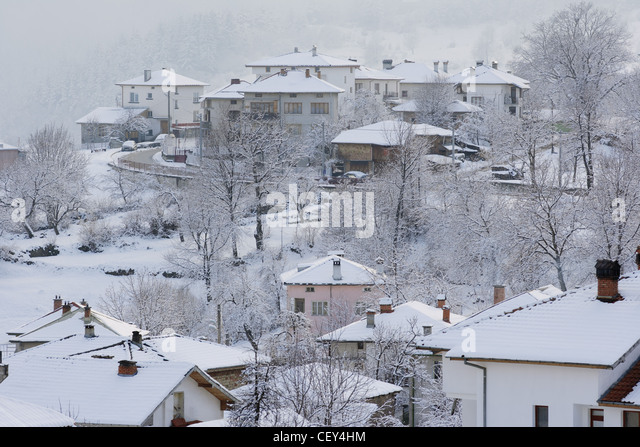 Snow covered houses in winter town of Smolian, Bulgaria - Stock Image