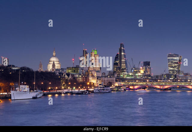 DUSK THAMES City of London lights and River Thames viewed from Waterloo Bridge at clear sunset dusk London UK - Stock Image