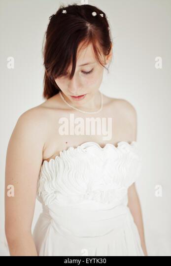 Young bride, downcast look, portrait, - Stock Image