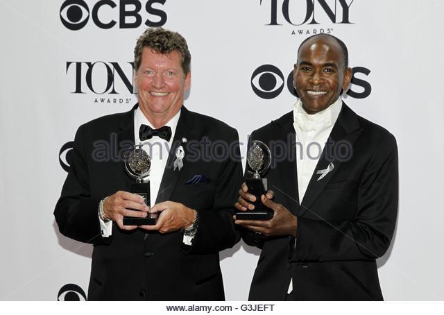 Lighting designer Howell Binkley (L) poses with his award for Best Lighting Design in a Musical for 'Hamiliton' - Stock Image