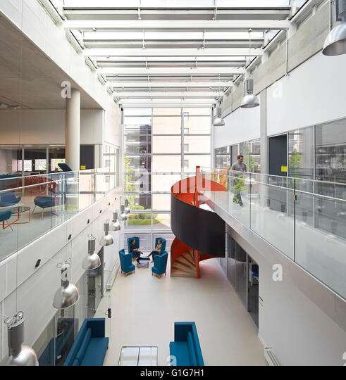 Elevated view of full-height foyer and arrival lounge. Graphene Institute, University of Manchester, Manchester, - Stock Image