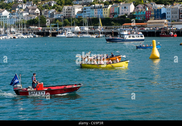 River Dart,Dartmouth Regatta gig racing with Kingswear in the background South Devon,Race Marshall watching gigs - Stock Image