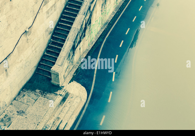 Italy, Rome, Flooded bicycle lane at Tiber river - Stock Image