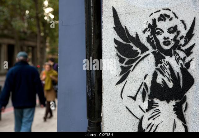 Marilyn Monroe as an angel stencil graffiti in London street - Stock Image
