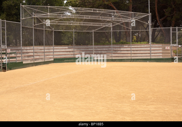 A baseball field, also called a ball field or a baseball diamond, is the field upon which the game of baseball is - Stock Image